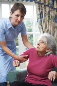 caregiver and unhappy elderly patient